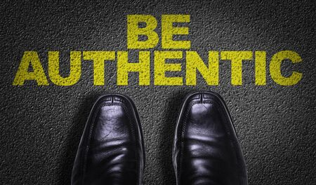 Business shoes on the floor with the words Be Authentic Фото со стока