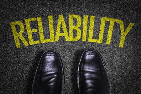Business shoes on the floor with the word Reliability