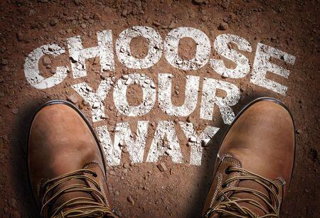 Boots on the trail with the words Choose Your Way Stok Fotoğraf - 129783476