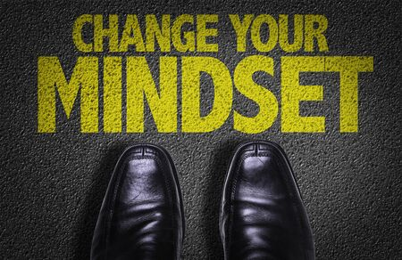 Business shoes on the floor with the words Change Your Mindset