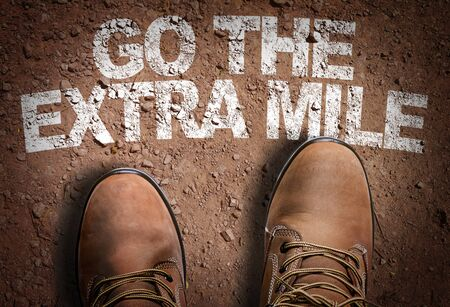 Boots on the trail with the words Go The Extra Mile