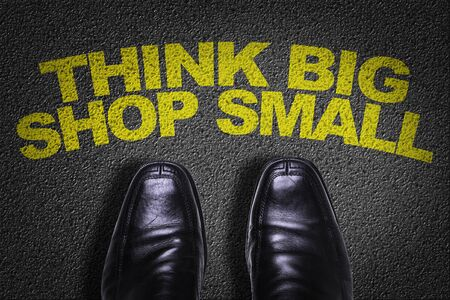 Business shoes on the floor with the words Think Big Shop Small