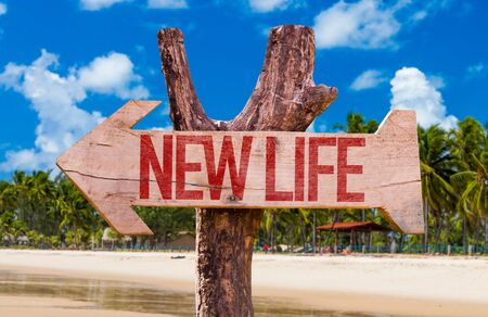 New life wooden signage at the beach 写真素材