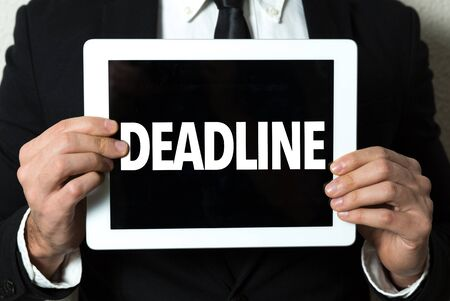 Person holding a tablet with deadline