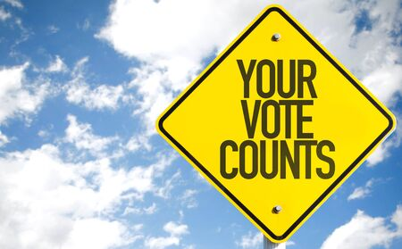 Your vote counts road sign with sky background