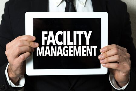 Person holding a tablet with facility management