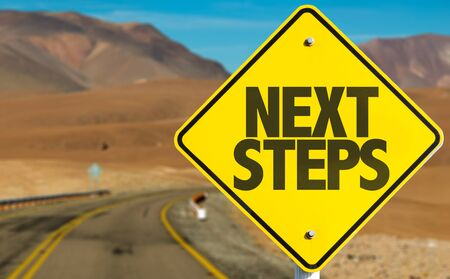 Next steps road sign with highway background Foto de archivo - 129783856