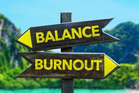 Balance or burnout signage by a lake Stock Photo