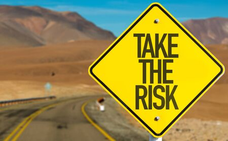 Take the risk road sign with highway background Foto de archivo - 129783919