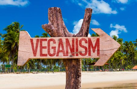 Veganism wooden signage at the beach Stock Photo