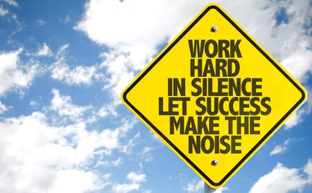 Work hard in silence let success make the noise Quote road sign with sky background Stock fotó