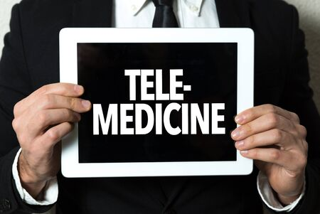 Person holding a tablet with telemedicine