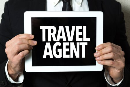 Person holding a tablet with travel agent