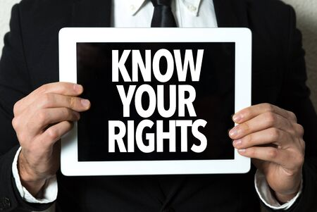 Person holding a tablet with Know Your Rights Banco de Imagens