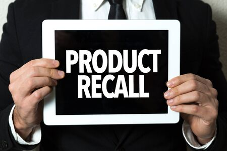 Person holding a tablet with Product Recall Stok Fotoğraf