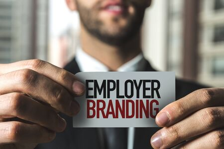 Person holding a card with Employer Branding