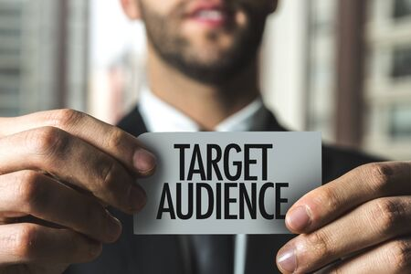 Person holding a card with Target Audience