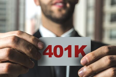 Person holding a card with 401k