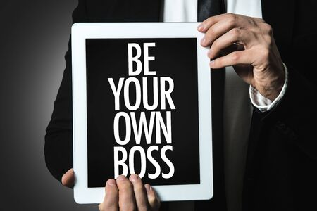 Person holding a tablet with Be Your Own Boss