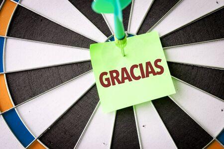 Dart with the word Gracias
