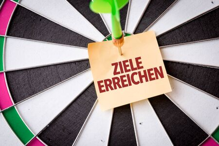 Dart with the words Ziele Erreichen 免版税图像