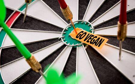Darts with the words Go Vegan 写真素材