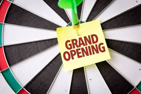Dart with the words Grand Opening