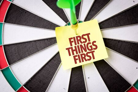 Dart with the words First Things First Stock Photo