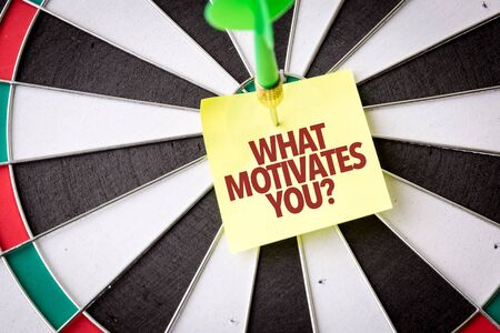 Dart with the words What Motivates You