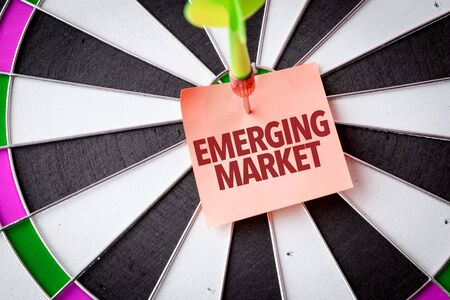 Dart with the words Emerging Market 写真素材