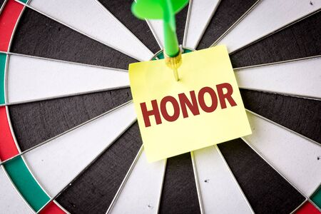 Dart with the word Honor Stock Photo