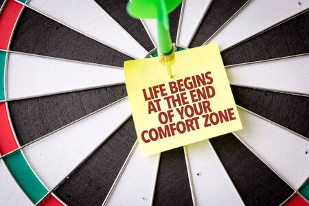 Dart with the words Life Begins As The End Of Your Comfort Zone
