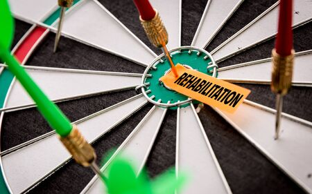Darts with the word Rehabilitation