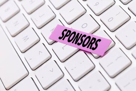 Sponsors sticky note on keyboard Reklamní fotografie