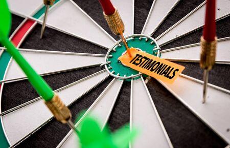 Testimonials sticky note on dart board