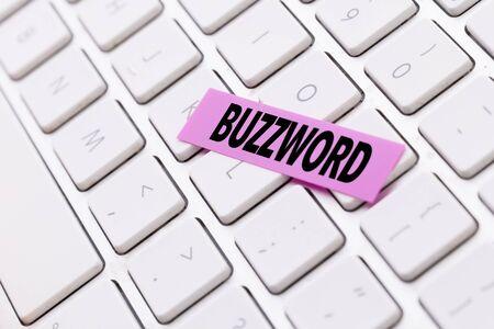 Buzzword sticky note on keyboard