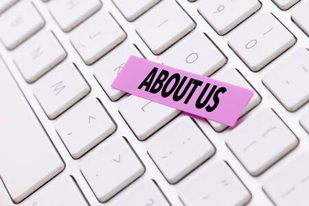 About us sticky note on keyboard