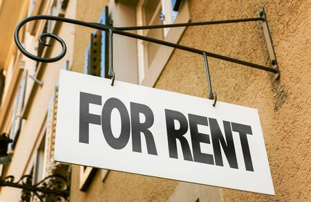 Signboard with the words For Rent