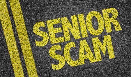 Senior Scam written on asphalt road Stockfoto