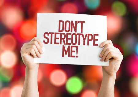 Person holding a placard with the words Dont Stereotype Me