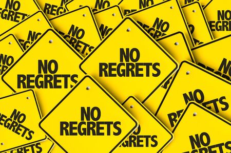 Signs with the words No Regrets Stock fotó