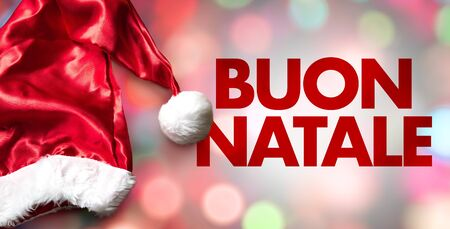 Santa hat with the words Buon Natale on bokeh background