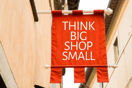 Think Big Shop Small sign in a street