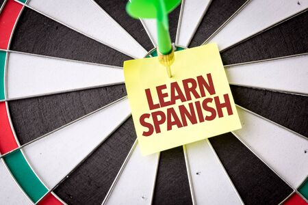 Learn Spanish sticky note on dart board