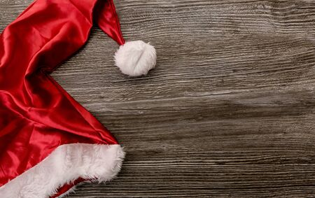 Santa hat on wooden background with copy space