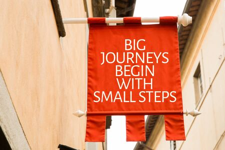 Big Journeys Begin With Small Steps sign in a street