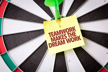 Dart with the words Teamwork Makes The Dream Work Archivio Fotografico
