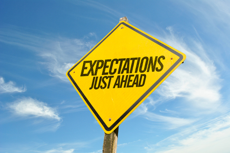 Expectations Just Ahead road sign