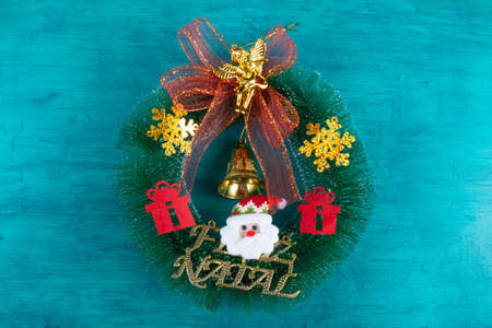 Christmas decoration with christmas wreath. Blue background