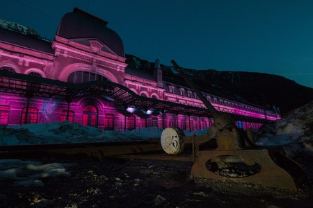 Old train station of Canfranc on a winter night with snow on the tracks, Huesca, Arag?n Spain
